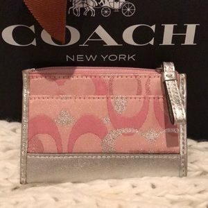 Baby pink and silver signature Coach coin purse